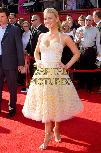 JESSICA SIMPSON .13th Annual ESPY Awards Arrivals held at the Kodak Theatre, Hollywood, California.  .July 13th, 2005.Photo Credit: Zach Lipp/AdMedia.half length yellow pattern print halterneck dress hands on hips.www.capitalpictures.com.sales@capitalpictures.com.© Capital Pictures.