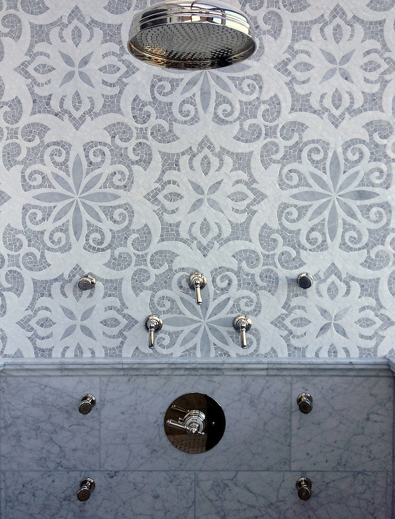 This custom shower features Arabella, a handmade mosaic shown in Carrara and Thassos, a part of the Silk Road Collection by Sara Baldwin for New Ravenna.<br /> <br /> For pricing samples and design help, click here: http://www.newravenna.com/showrooms/