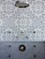 This custom shower features Arabella, a handmade mosaic shown in Carrara and Thassos, a part of the Silk Road Collection by Sara Baldwin for New Ravenna.<br />