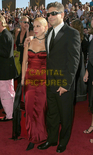 MICHAEL IMPERIOLI.6th Annual Prime Time Emmy Awards held at the Shrine Auditorium. .September 19th, 2004.full length, red strapless dress, black suit, sunglasses, shades.www.capitalpictures.com.sales@capitalpictures.com.©Don Shaffer/AdMedia/Capital Pictures.