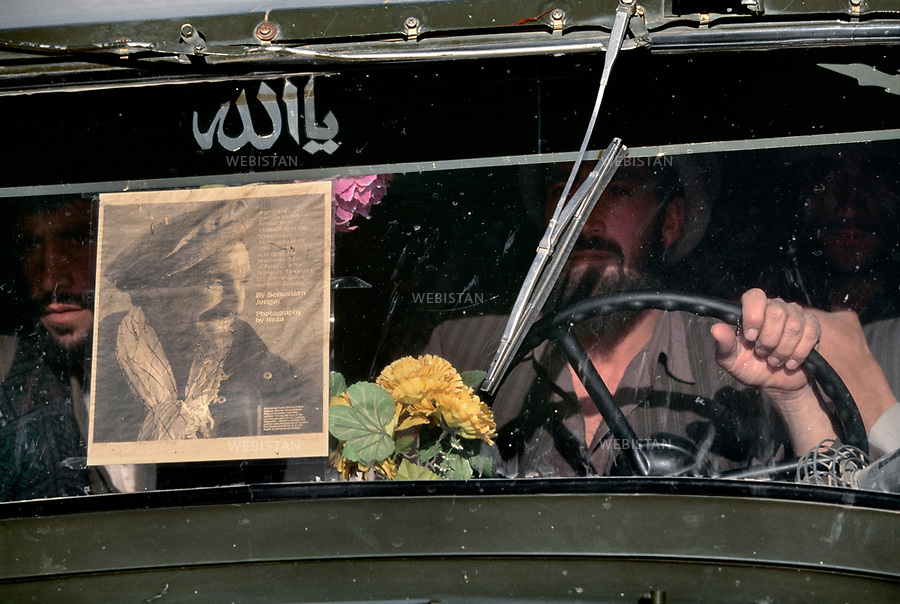 Afghanistan. Portrait of Commander Massoud (1953-2001) by Reza on the front window of a car. This photo has become one of his iconic photos by Reza.
