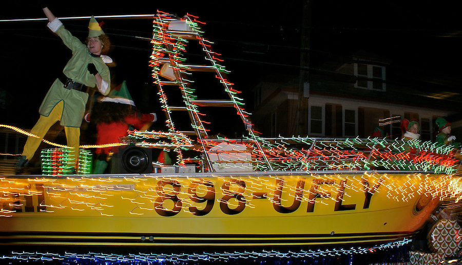 Cape May holiday celebration parade with boat and singer