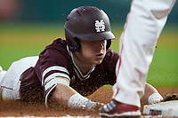 Rowdey Jordan (4) of the Mississippi State Bulldogs slides head first into third base during the game against the Louisiana Ragin' Cajuns in game three of the 2018 Shriners Hospitals for Children College Classic at Minute Maid Park on March 2, 2018 in Houston, Texas.  The Bulldogs defeated the Ragin' Cajuns 3-1.   (Brian Westerholt/Four Seam Images)