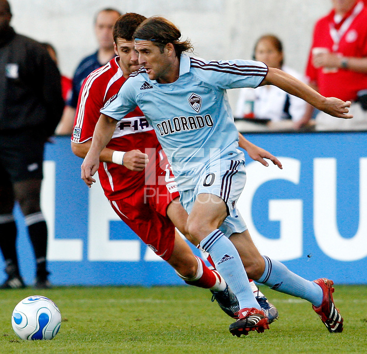 Colorado Rapids forward Nicolas Hernandez (20) dribbles away from Chicago Fire defender Gonzalo Segares (25).  The Chicago Fire tied the Colorado Rapids 0-0 at Toyota Park in Bridgeview, IL on July 1, 2007.