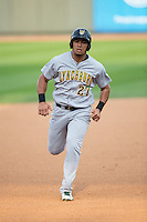Anthony Santander (27) of the Lynchburg Hillcats hustles towards third base against the Winston-Salem Dash at BB&T Ballpark on April 28, 2016 in Winston-Salem, North Carolina.  The Dash defeated the Hillcats 4-1.  (Brian Westerholt/Four Seam Images)
