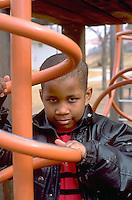 Child age 5 playing on school playground.  St Paul  Minnesota USA