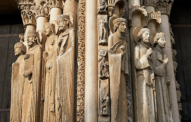 West Facade, Central Portal - Right Jamb Figures- General View c. 1145. Cathedral of Chartres, France . Gothic statues of figures. The group to the left some scholars believe that the jamb figures are the ancestors of Christ.. A UNESCO World Heritage Site.