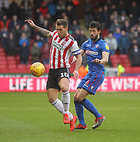Bolton Wanderers Jason Lowe in action with Sheffield United's Billy Sharp<br /> <br /> Photographer Mick Walker/CameraSport<br /> <br /> The EFL Sky Bet Championship - Sheffield United v Bolton Wanderers - Saturday 2nd February 2019 - Bramall Lane - Sheffield<br /> <br /> World Copyright © 2019 CameraSport. All rights reserved. 43 Linden Ave. Countesthorpe. Leicester. England. LE8 5PG - Tel: +44 (0) 116 277 4147 - admin@camerasport.com - www.camerasport.com