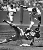 San Francisco Giants Robby Thompson completes double-play over the sliding Mike Scioccia of the Los Angeles Dodgers. (1986 photo by Ron Riesterer)