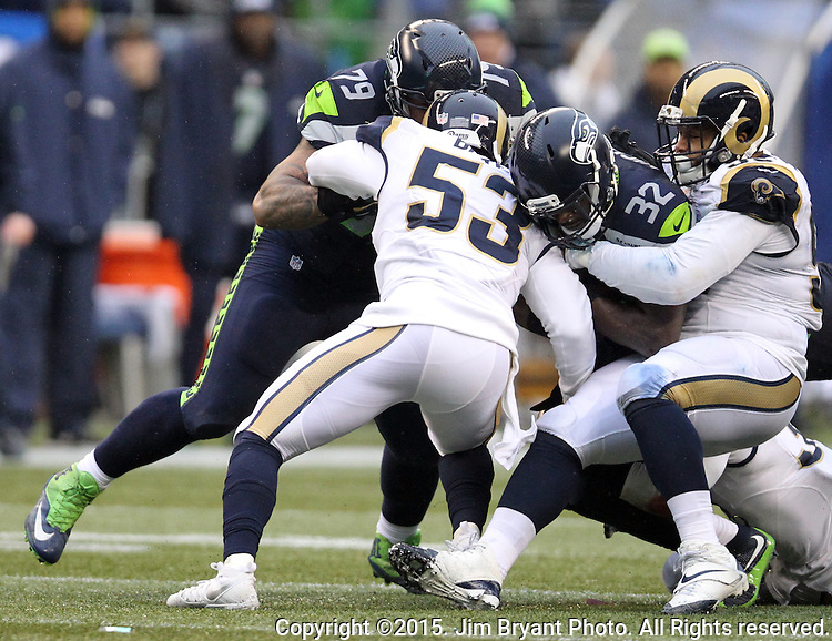 St. Louis Rams Daren Bates (53) and William Hayes (95) bring down Seattle Seahawks running back Christian Michael (32) at CenturyLink Field in Seattle, Washington on December 27, 2015.  The Rams beat the Seahawks 23-17.      ©2015. Jim Bryant Photo. All Rights Reserved