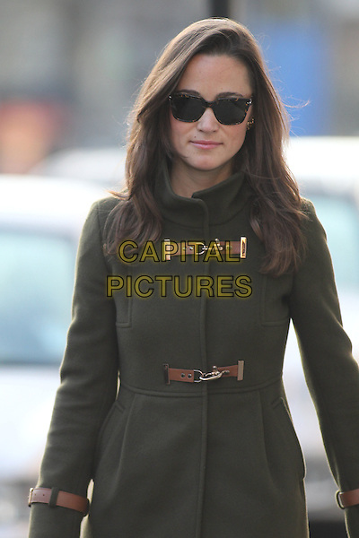 Pippa Middleton arrives for work, London, Engalnd..December 2nd, 2011.half length green jacket buckles sunglasses shades.CAP/HIL.©John Hillcoat/Capital Pictures.