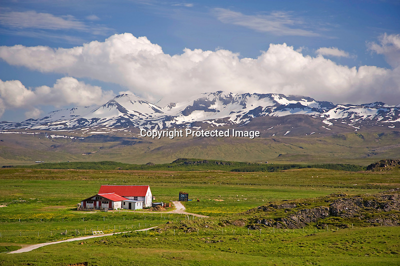 View of Snow Capped Mountains and Helgafell Valley near Stykkisholmur in Iceland