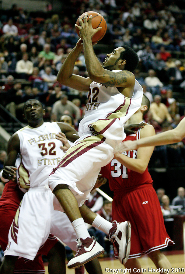 TALLAHASSEE, FL 10-FSU-NCSTBB10 CH13-Florida State's Derwin Kitchen goes up for a shot against N.C. State's during second half action Tuesday at the Donald L. Tucker Center in Tallahassee. The Wolfpack beat the Seminoles 88-81...COLIN HACKLEY PHOTO
