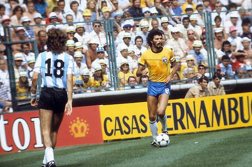 02.07.1982 Barcelona, Spain. Socrates (Brasil) covered by Alberto Tarantini (Argentina); Argentinien versus Brasil ended 1:3 in Barcelona