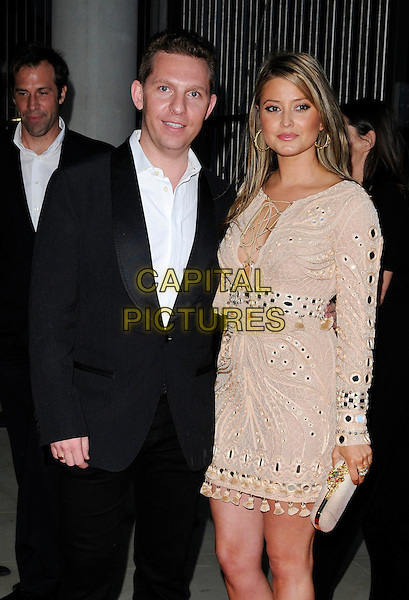 Nick Candy & Holly Valance .attending the McLaren Automotive Showroom Launch at One Hyde Park, Knightsbridge, London, England, UK, June 21st 2011..half length beige nude dress long sleeve couple grey gray black suit white shirt tassels lace-up kaftan sandals clutch bag gold embellished .CAP/CAN.©Can Nguyen/Capital Pictures.