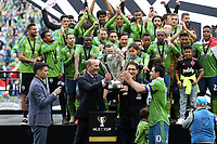 SEATTLE, WA - NOVEMBER 10: MLS Commissioner Don Garber presents the Philip F. Anschutz Trophy to Seattle Sounders FC team captain Nicolas Lodeiro #10 during a game between Toronto FC and Seattle Sounders FC at CenturyLink Field on November 10, 2019 in Seattle, Washington.