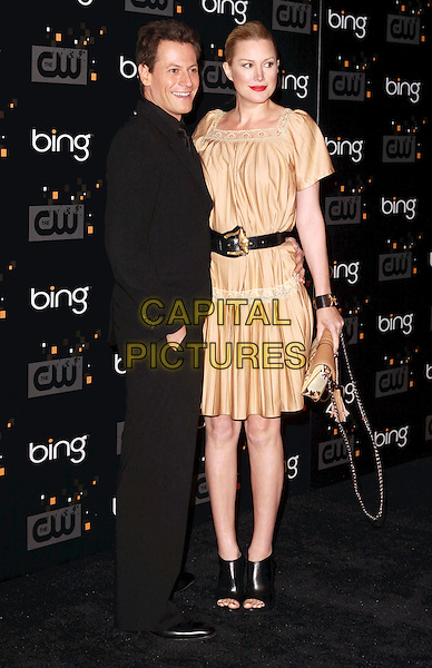 Ioan Gruffudd and Alice Evans.Bing Presents The CW Premiere Party for the New Fall Season Show Lineup held at Warner Bros Studio Lot, Burbank, California, USA..September 10th, 2011.full length black suit gold silk satin dress side married husband wife belt.CAP/ADM/CH.©Charles Harris/AdMedia/Capital Pictures