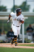 GCL Pirates outfielder Edison Lantigua (31) runs to first during the second game of a doubleheader against the GCL Yankees 2 on July 31, 2015 at the Pirate City in Bradenton, Florida.  The game was suspended after two innings due to rain.  (Mike Janes/Four Seam Images)
