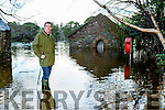 Frank McMahon assesses the fllood waters at Dundeag boathouse in Muckross House gardens on Tuesday