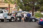 "Titan Towing is staging an employee in the Blind Tiger Bar parking lot on Pecos in the same community parking lot as immigration from 8am until about 3pm, <br /> Although their side of the Lot is veaguly mark with signs at each end of the lot and stencil ""Bar Parking on the curb stop. The Titan employee waits until the driver is out of site and takes photos, calls wrecker, sweeps the lot three cars at a time then waits for the next round 18+ cars the first day 24+ cars on the 2nd day, @200.00 per car if you can get it out the same day. THe bar has 60 plus spots , and 2 + customers in the morning"