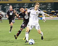 Andy Najar #14 of D.C. United runs into Michael Stephens #26 of the Los Angeles Galaxy during an MLS match at RFK Stadium on July 18 2010, in Washington D.C. Galaxy won 2-1.
