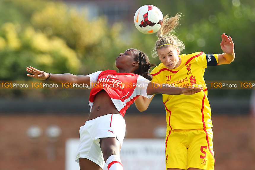 Gemma Bonner of Liverpool Ladies rises above Danielle Carter of Arsenal Ladies - Arsenal Ladies vs Liverpool Ladies - FA Womens Super League Football at Meadow Park, Boreham Wood FC  - 05/10/14 - MANDATORY CREDIT: Gavin Ellis/TGSPHOTO - Self billing applies where appropriate - contact@tgsphoto.co.uk - NO UNPAID USE