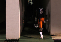 Virginia quarterback David Watford (5) walks into the darkened tunnel after the 59-10 loss to Clemson Saturday at Scott Stadium in Charlottesville, VA. Photo/Andrew Shurtleff
