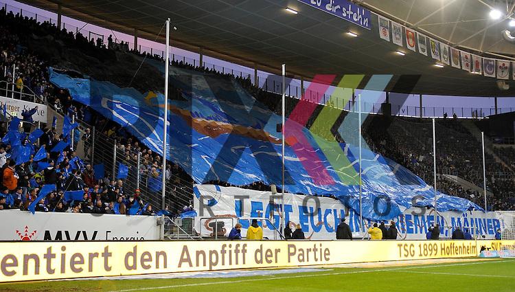 Die Hoffenheimer Fans mit einer Choreografie beim Spiel in der Bundesliga TSG 1899 Hoffenheim (blau) - SV Darmstadt 98 (orange).<br /> <br /> Foto &copy; PIX-Sportfotos *** Foto ist honorarpflichtig! *** Auf Anfrage in hoeherer Qualitaet/Aufloesung. Belegexemplar erbeten. Veroeffentlichung ausschliesslich fuer journalistisch-publizistische Zwecke. For editorial use only.