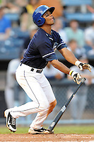 Asheville Tourists second baseman Russell Wilson #3 swings at a pitch during a game against the Rome Braves at McCormick Field on June 23, 2011 in Asheville, North Carolina.  The Tourists won the game 10-4.  (Tony Farlow/Four Seam Images)