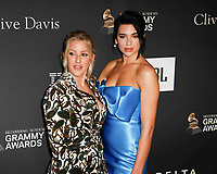 BEVERLY HILLS, CA- FEBRUARY 09: Ellie Goulding and Dua Lipa at the Clive Davis Pre-Grammy Gala and Salute to Industry Icons held at The Beverly Hilton on February 9, 2019 in Beverly Hills, California.      <br /> CAP/MPI/IS<br /> &copy;IS/MPI/Capital Pictures