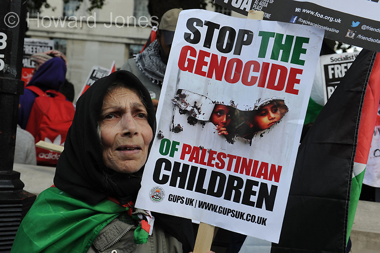 London: Hundreds of protestors call on the UK Government to stop arming Israel.<br /> <br /> Demonstrators gathered outside Downing Street to demand that the government revoke all export licenses to Israel. It had been reported that the government had warned that the licenses would be suspended if the hostilities continued.