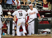 May 30, 2011; Phoenix, AZ, USA; Arizona Diamondbacks batter Justin Upton is congratulated by manager Kirk Gibson after hitting a two run home run in the seventh inning against the Florida Marlins at Chase Field. Mandatory Credit: Mark J. Rebilas-
