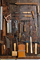 Tools of the trade - in the workshop (bottega) of artisan book-binder (rilegatore) Enrico Giannini, Via dei Velluti in Florence, Italy