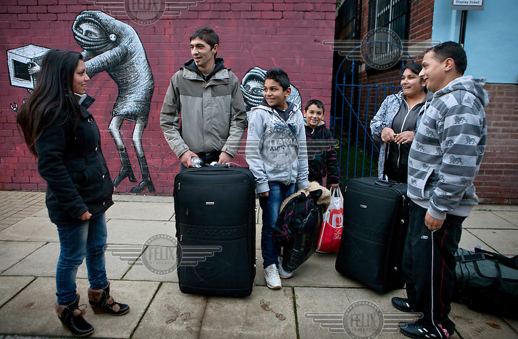 A group of Roma, newly arrived from Slovakia, alight from a coach in a side street near the train station in Sheffield. The district of Page Hall in Sheffield has been described by the national media as a hotbed of tension between the Slovak Roma community, many of whom are newly arrived in the UK, and the Pakistani community, who have been in the UK for much longer. In reality there are some Roma who have lived in the area for a number of years. Many more considered commentators blame tensions on the cultural misunderstandings combined with the area's social deprivation and unemployment.