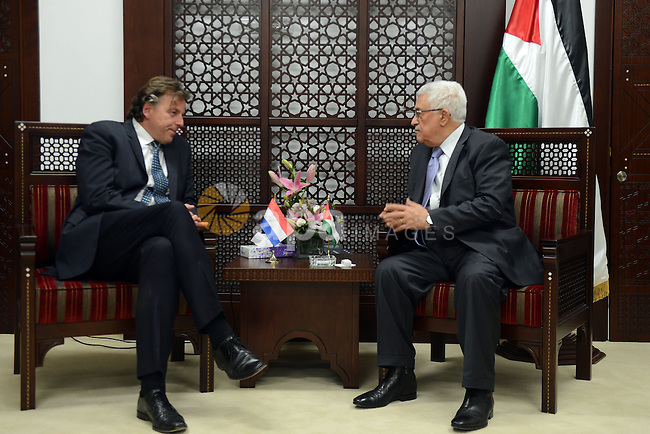 Palestinian President, Mahmoud Abbas (Abu Mazen) meets with Dutch Foreign Minister Bert Koenders, in the West Bank city of Ramallah, on 14 July 2015. Koenders is on a visit to the West Bank. Photo by Thaer Ganaim