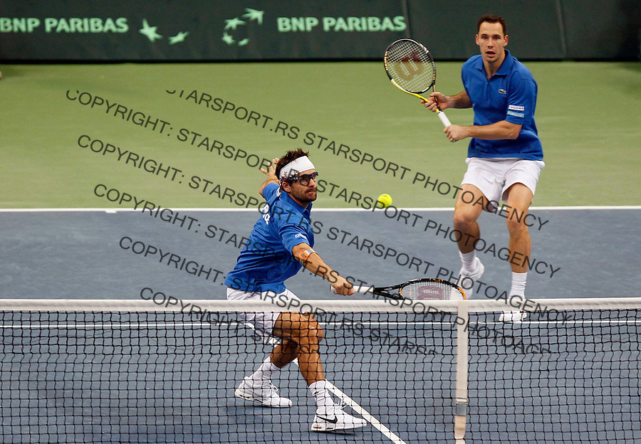 French Davis Cup players Michael Llodra, right and Arnaud Clement returns the ball during their dubles match against Nenad Zimonjic and Viktor Troicki of Serbia. France leads 2:1 with only two matches remaining on Sunday. Davis Cup finals, Serbia vs France in Belgrade Arena in Belgrade, Serbia, Saturday, 4. December 2010. (credit & photo: Srdjan Stevanovic/Starsportphoto.com©)