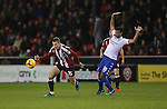 Paul Coutts of Sheffield Utd challenged by Jacob Mellis of Bury during the English League One match at the Bramall Lane Stadium, Sheffield. Picture date: November 22nd, 2016. Pic Simon Bellis/Sportimage