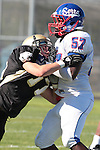 Palos Verdes, CA 09/24/10 - Blake Allman (Peninsula #77) and Joshua Williams (Serra #57)  in action during the Serra-Peninsula varsity football game at Peninsula High School.
