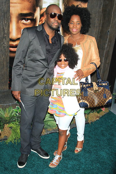 Wyclef Jean and family<br /> The New York Premiere of &quot;After Earth&quot; at the Ziegfeld Theatre, New York, NY., USA.<br /> May 29th, 2013<br /> full length black suit sunglasses shades white beige leather jacket <br /> CAP/LNC/TOM<br /> &copy;LNC/Capital Pictures
