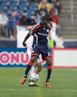 New England Revolution midfielder Shalrie Joseph (21) attempts to control a pass. The New England Revolution out scored the Chicago Fire, 2-1, in Game 1 of the Eastern Conference Semifinal Series at Gillette Stadium on November 1, 2009.
