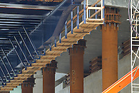Supports and Cast-in-place underpinnig, New Pearl Harbor Memorial Bridge under Construction at New Haven Harbor Crossing, Connectictut. CONNDOT Contract B, Project #92-618. When complete the alternately named Quinnipiac River Bridge will be first Extradosed Engineered & Designed Bridge in the United States.