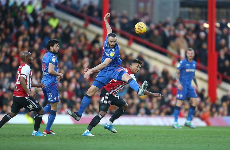 Bolton Wanderers' Marc Wilson and Brentford's Ollie Watkins<br /> <br /> Photographer Rob Newell/CameraSport<br /> <br /> The EFL Sky Bet Championship - Brentford v Bolton Wanderers - Saturday 22nd December 2018 - Griffin Park - Brentford<br /> <br /> World Copyright © 2018 CameraSport. All rights reserved. 43 Linden Ave. Countesthorpe. Leicester. England. LE8 5PG - Tel: +44 (0) 116 277 4147 - admin@camerasport.com - www.camerasport.com