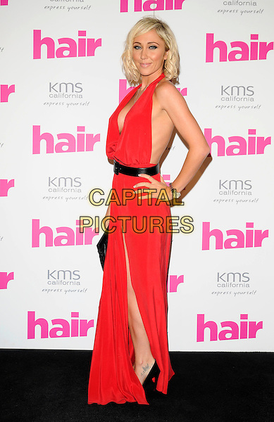 JENNY FROST.The Hair Magazine Awards, Grosvenor Place, London, England. .September 29th, 2009 .full length red pink halterneck dress slit split tattoo hand on hip cleavage plunging neckline maxi.CAP/CAN.©Can Nguyen/Capital Pictures.