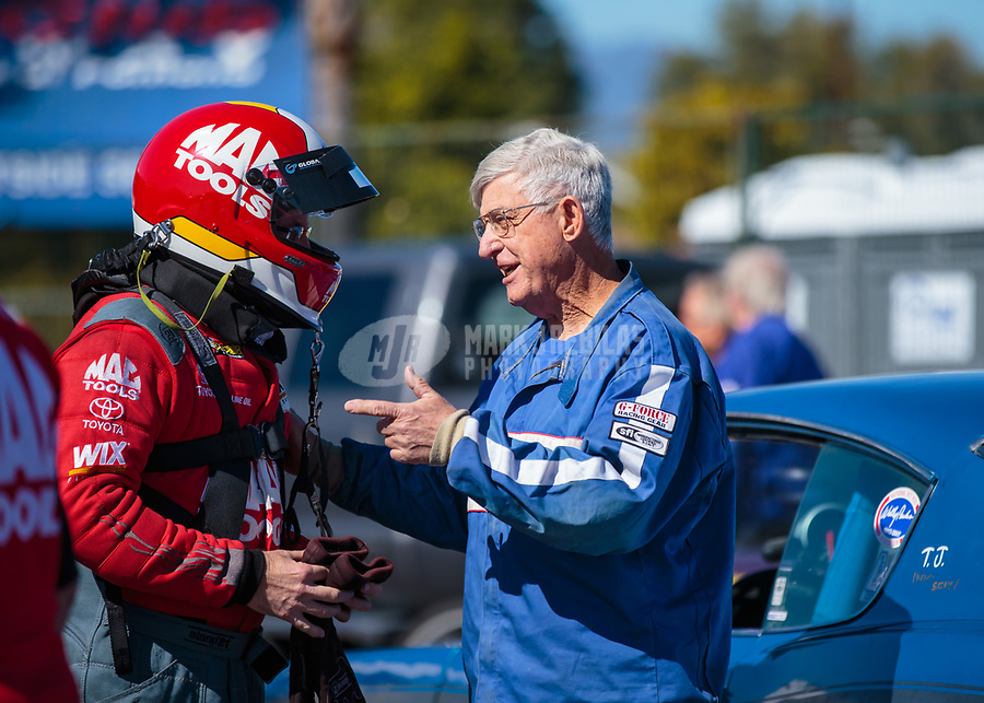 Feb 11, 2019; Pomona, CA, USA; NHRA top fuel driver Doug Kalitta (left) talks with stock eliminator driver Earl Blake during the Winternationals at Auto Club Raceway at Pomona. Mandatory Credit: Mark J. Rebilas-USA TODAY Sports