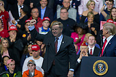 Rick Saccone, Republican Congressional candidate for Pennsylvania's 18th district, appears on stage with United States President Donald J. Trump as he speaks to supporters during a Make American Great Rally at Atlantic Aviation in Moon Township, Pennsylvania on March 10th, 2018. Credit: Alex Edelman / CNP