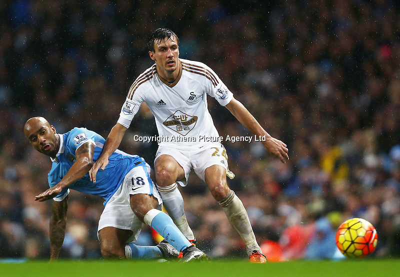 Fabian Delph of Manchester City and Jack Cork of Swansea City during the Barclays Premier League match between Manchester City and Swansea City played at the Etihad Stadium, Manchester on December 12th 2015