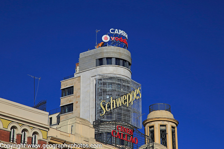 Buildings neon advert signs on Callao plaza square in Madrid city centre, Spain