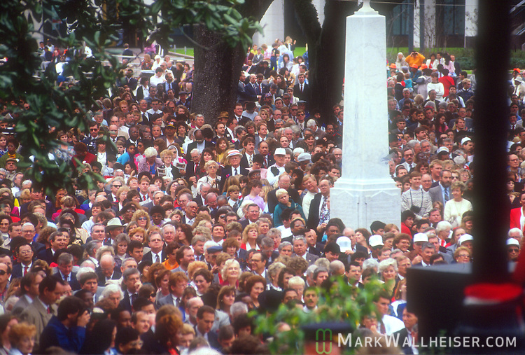 The crowd on the front lawn of the old Florida Capitol watches as Rhea Chiles (center) holds the bible, Lawton Chiles (L)  is sworn in by Florida Chief Justice Leander. Shaw as Florida's 41st Governor on January 8, 1991 on the front steps of the Florida Capitol in Tallahassee, Florida.