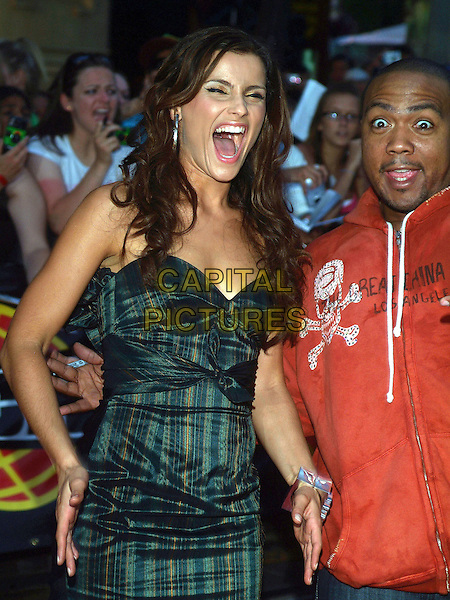 NELLY FURTADO & TIMBALAND.17th Annual MuchMusic Video Awards, CHUM City Building, Toronto, Ontario, Canada, USA..June 18th, 2006.Photo: Brent Perniac/AdMedia/Capital Pictures.Ref: BP/ADM.half length funny mouth open green satin strapless striped stripes dress.www.capitalpictures.com.sales@capitalpictures.com.© Capital Pictures.