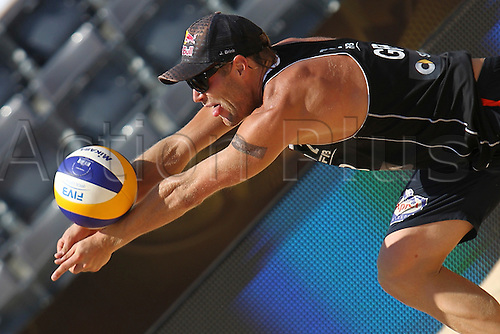 15.06.2011 Day three of the Beach Volleyball World Championships from Rome. Match Brink - Reckermann (GER) [4] VS Heuscher - Bellaguarda (SUI) [21]. The  Picture shows  Jonas Reckermann (GER) great defend during the match.